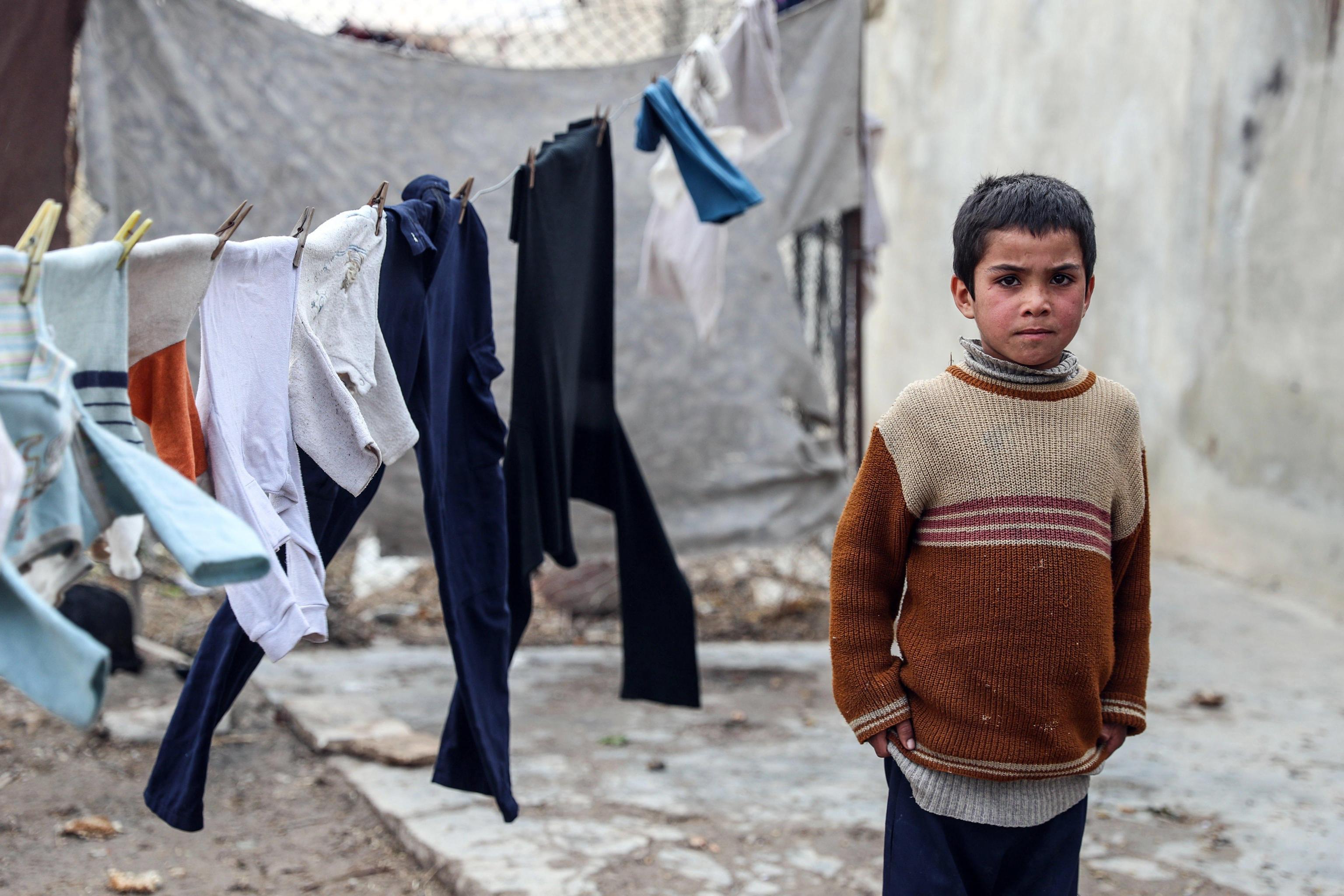 Un bambino siriano sfollato