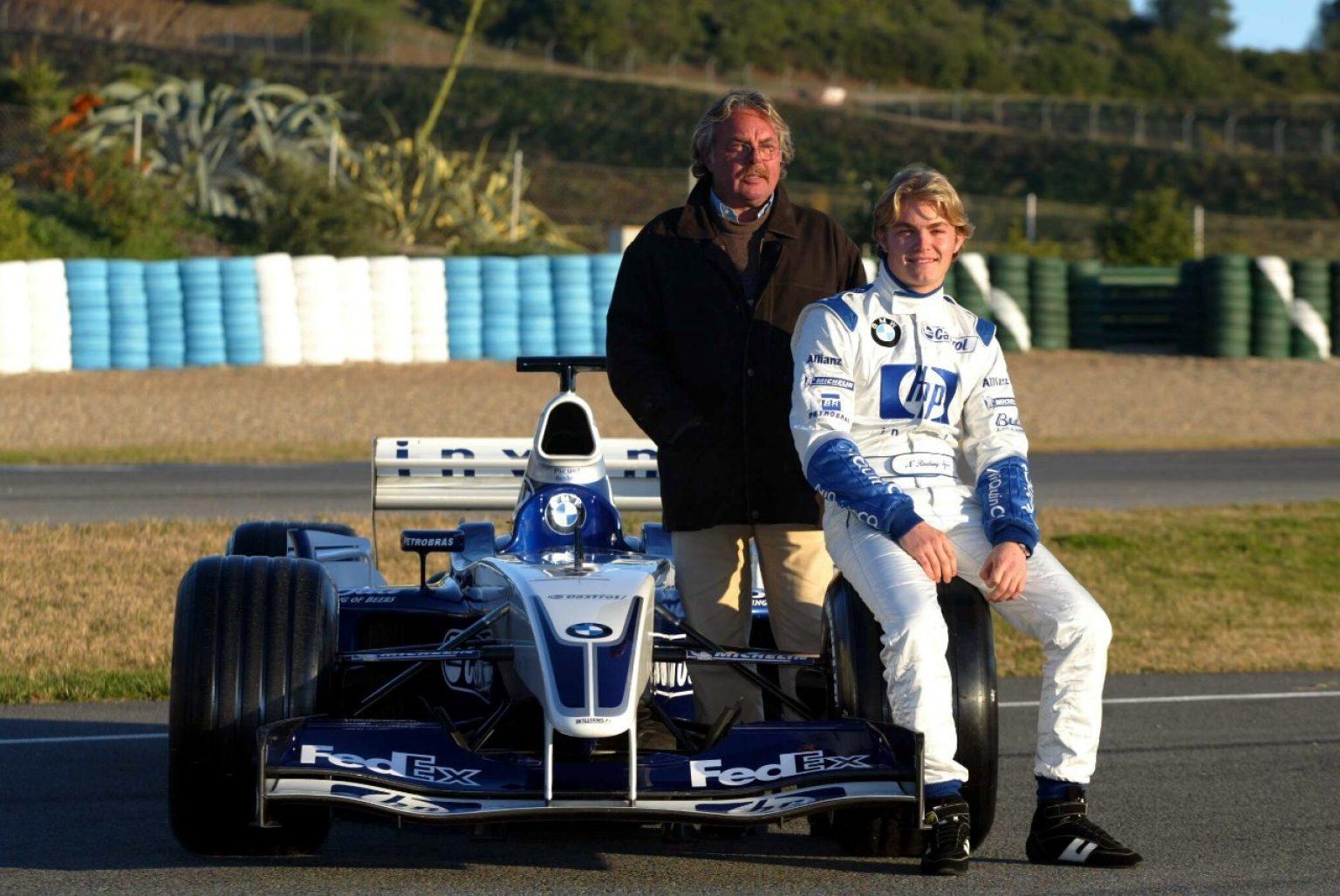 2A Padre e figlio durante un test di Formula Uno nel 2003